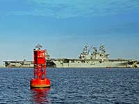 Red buoy and battleships