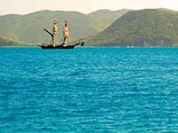 Square-rigger drifting past Tortola