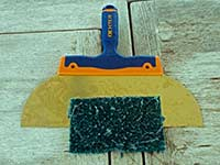 Scraper and abrasive pad for bottom cleaning