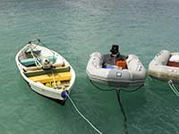 Three beat-up dinghies