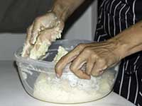 Carmen preparing bread dough