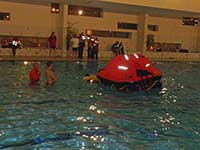 ISAF Training - entering a liferaft